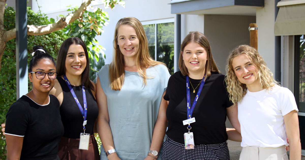 PBS team standing in sensory garden. From left to right, Brindha, Helena, Davinia, Amelia and Sophie